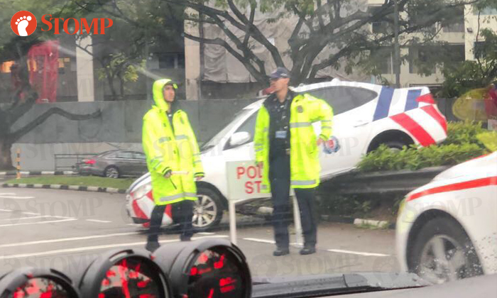 A police car was seen on the road divider along Kampong Road yesterday. (Jan 26)