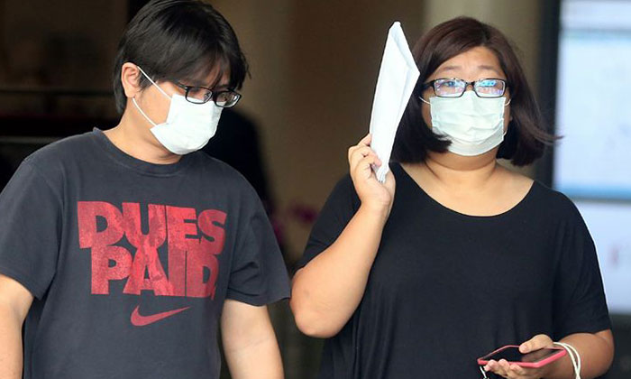 Liu Chin Guan, 36, (left) and his wife, Angela Lim Xiu Yan, 32, were sentenced to jail and fined for running a vice website.