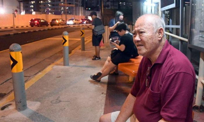 Mr Chen (rightmost) told reporters that he waited by the bus stop for over two hours.