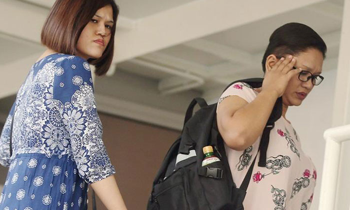 (From left) Sisters Haslinda and Hasniza Ismail and their mother Hasmah Sulong (not pictured) were each charged with one count of causing grievous hurt to a 27-year-old woman.ST PHOTO: WONG KWAI CHOW