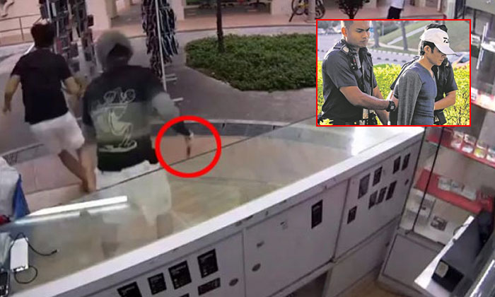 The suspect draw a knife and chased after the employee, as seen in CCTV footage. He was arrested from his flat and led away by police officers. (right inset) PHOTO: LIANHEWANBAO