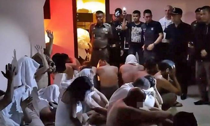 The suspects were found naked on the ground floor of the hotel. PHOTO: SHIN MIN DAILY NEWS