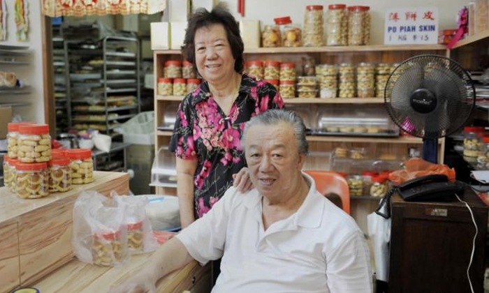Mr Ng Sew Kuang (right) and his wife at their confectionery, Ng Kian Seng Confectionery. Photos: The Straits Times