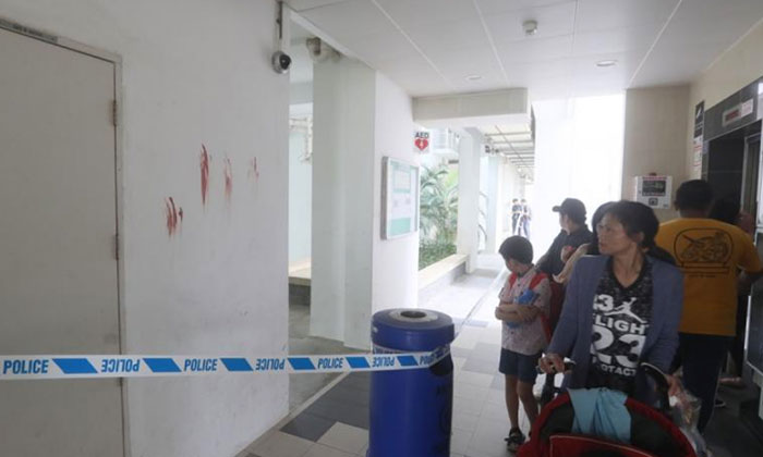 Residents have been unsettled by the bloody palm prints left at the void deck. PHOTO: LIANHE WANBAO