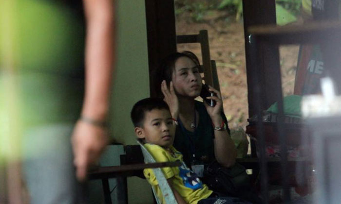 Family members of the schoolboys trapped inside Tham Luang cave in Thailand's Chiang Rai province wait in a room during rescue operations on July 8, 2018.PHOTO: EPA-EFE