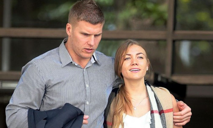 (Left) Males Milan, 29, Australian national and his wife Filimonova Svetlana. 29, Russian national, accused for using criminal force to Assistant Superintendent of Police on duty and caused public disturbance at outside club Altimate, Raffles Place. Photo: The Straits Times