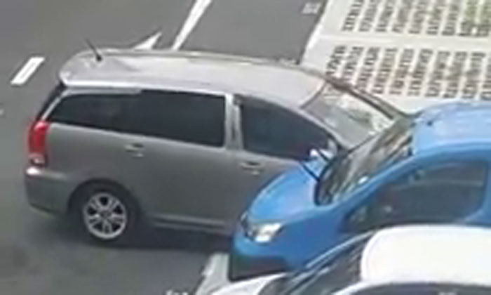 Watch this driver struggle to reverse out of parking lot