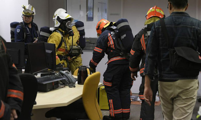 Police and SCDF officers investigating a suspicious letter at the newsroom of The Straits Times in Toa Payoh on Nov 2, 2018. ST PHOTO: MARK CHEONG