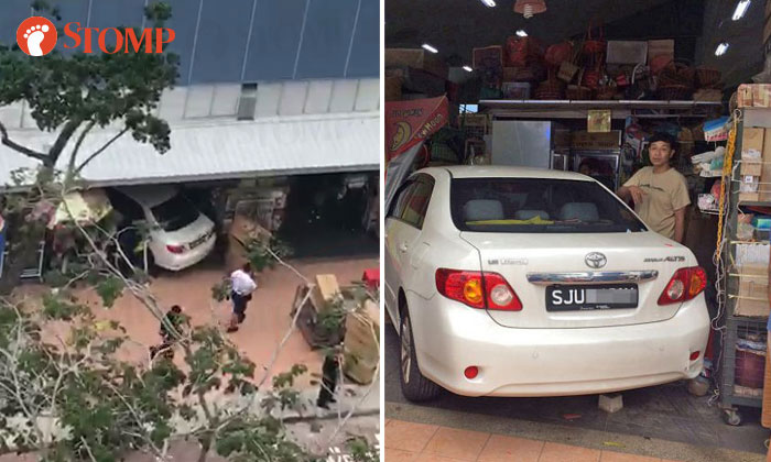 Lim Soon Wai lost control of his car and crashed head-on into a florist's stall in Marine Terrace market on Dec 9, 2017. PHOTOs: STOMP, SHIN MIN READER