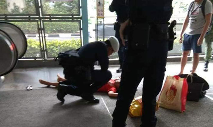 The 41-year-old maid was seen lying at the foot of the escalator at Clementi MRT Station on Friday. PHOTO: FACEBOOK