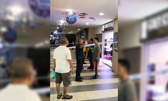 The scene at Yew Tee Square shopping mall on Saturday (Dec 15), where a thief stole three necklaces and a pendant from a jewellery store in the daytime. PHOTO: WANBAO READER