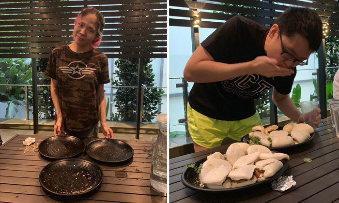 Malaysian top competitive eater Rainbow Kumi (left) and rookie Joshua Tan (right) participating in a pork bun eating contest at Attitude Inn.