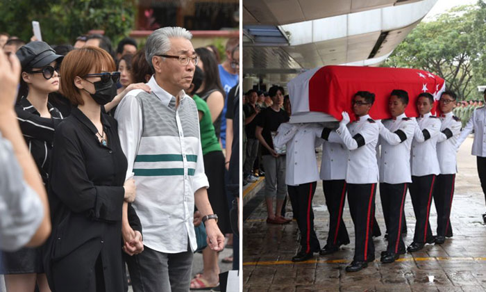 (From left) Actress Hayley Woo, her twin sister Jayley and actor Chen Shucheng walking behind the hearse of late actor Aloysius Pang, on Jan 27, 2019. ST PHOTO: JASMINE CHOONG. (Right) SAF personnel carrying the coffin of Aloysius Pang into Mandai Crematorium, on Jan 27, 2019. ST PHOTO: TIMOTHY DAVID
