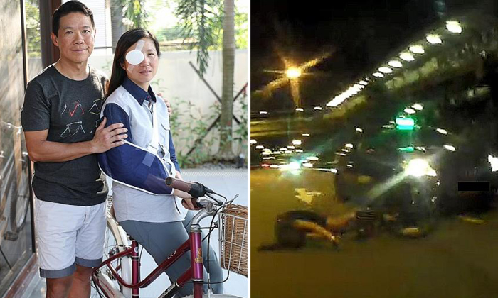 Dr Lynette Ngo (above, with husband Dr Hing Siong Chen) suffered severe injuries after she was hit by a cab when she was cycling along Braddell Road. Photo: The New Paper