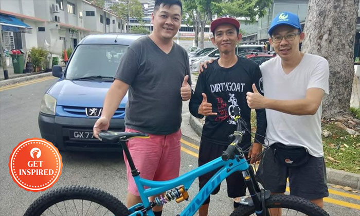 (From left) Calvin, the man who found his bike and Calvin's friend.
