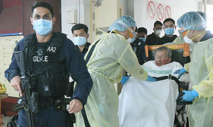 The victim was taken to Tan Tock Seng Hospital, while his father, identified only as Mr Wu, was taken to Raffles Hospital. PHOTO: SHIN MIN DAILY NEWS