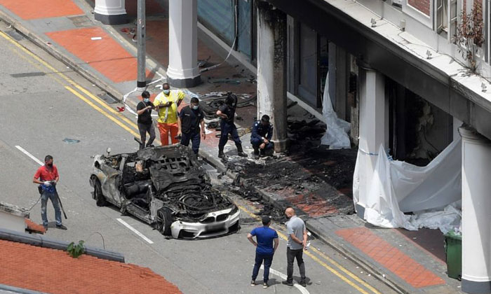 The car was believed to have sped along Tanjong Pagar Road before colliding into a shophouse and catching fire. ST PHOTO: ALPHONSUS CHERN