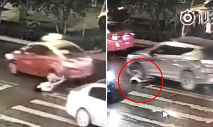 Woman in China gets hit by car -- then gets run over by SUV