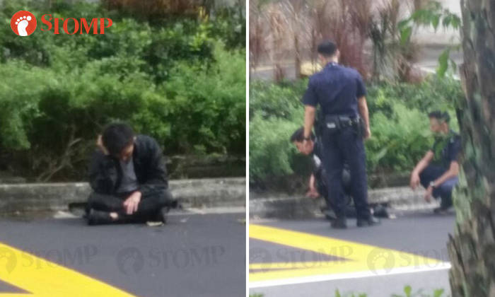 Police Seen Speaking To Drunk Man Sitting Down Along Orchard Road