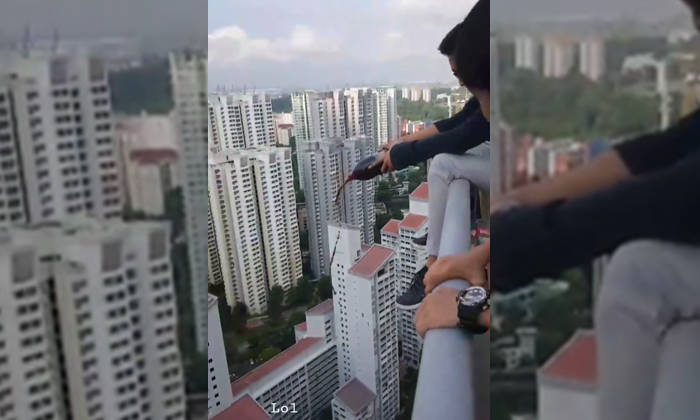 Youth Sits On Ledge And Pours Coke Down Building In Expletive Laden Instagram Video