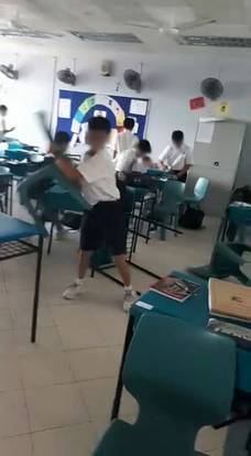 Boys School Students Throw Tables Chairs In Classroom