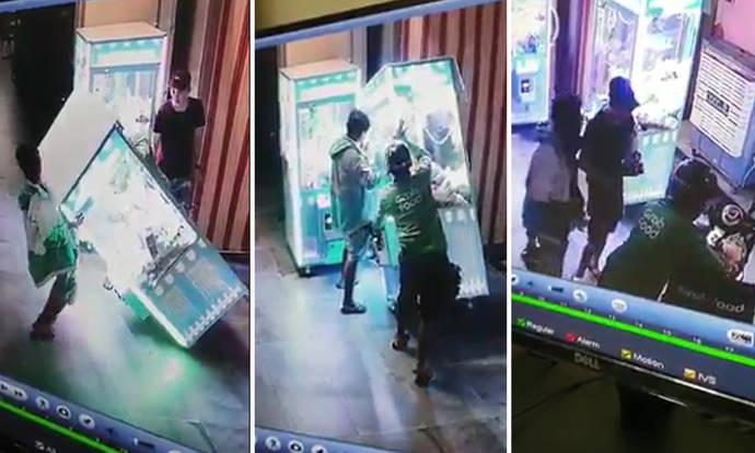Men shake over 10 toys out of Clementi claw machine and hide them in food delivery bag - Stomp