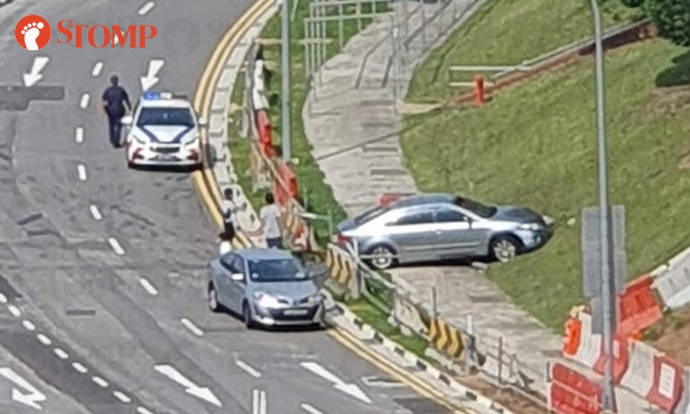 Car crashes through railing and ends up on pavement along Sin Ming Avenue - Stomp