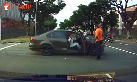 Car nearly collides into motorcycle at uncontrolled cross junction in Tuas
