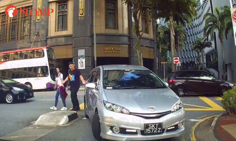 Driver makes wrong turn into North Bridge Rd carpark, then almost reverses into couple