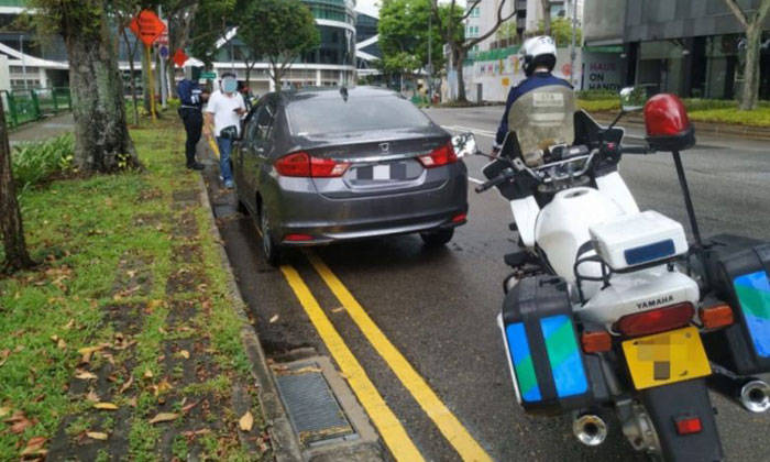 LTA officers conducting enforcement operations against illegal car-pooling services along Handy Road on April 22-23. PHOTO: LAND TRANSPORT AUTHORITY