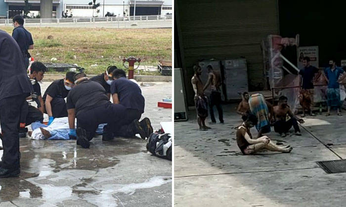 SCDF officers tending to a worker who was injured in an explosion in an industrial building in Tuas on Feb 24, 2021. PHOTOS: LIANHE ZAOBAO/SCREENSHOTS FROM CIRCULATED VIDEOS