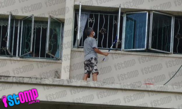 So dangerous! Man climbs out on to parapet on 7th storey to clean windows at Tampines Ave 8