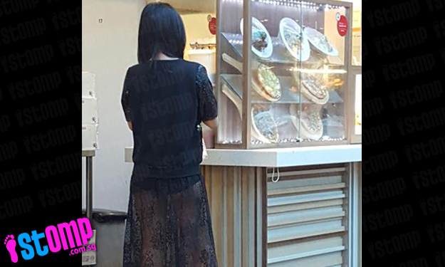 Fashion trend or wardrobe malfunction? Woman's translucent skirt leaves passers-by at Lot 1 baffled
