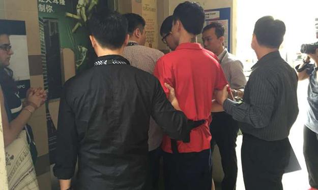 Teenagers accused of setting fire to Lengkok Bahru flat in loansharking case taken back to crime scene